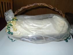neck roll pillow in basket by etc